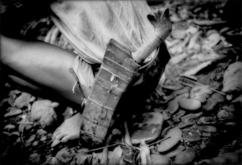Iban Dayak hunter's knife deep in the rainforest, Sungai Lalang River, Sarawak, Malyasian Borneo.