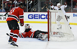 Mar 12, 2009; Newark, NJ, USA; Phoenix Coyotes left wing Petr Prucha (16) celebrates behind New Jersey Devils goalie Martin Brodeur (30) after a goal by Phoenix Coyotes left wing Scottie Upshall (8) during the first period at the Prudential Center.
