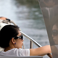 A tourist takes in the sights from a solar-powered boat on the Love River.