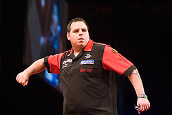 Adrian Lewis v Raymond van Barneveld in the first match..2010 Whyte & MacKay Premier League Darts week nine, Glasgow SECC..©2010 Michael Schofield. All Rights Reserved.