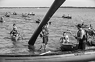 The 35th Annual Paddle & Portage was held Saturday, July 19, 2014, starting at James Madison Park in Madison, Wisconsin. The race included a 1.5 mile loop in Lake Mendota, a portage up North Hamilton Street,  and around part of the Capitol Square, then into Lake Monona where they finish at Olin Park.