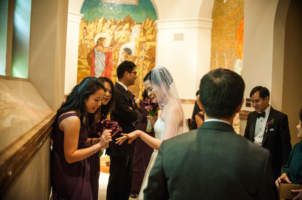 Photo by Matt Roth.Assignment ID: 10137951A..Caroline Trang Nguyen shows off her wedding ring to her cousins Carolyn and Victoria Thai after she married Daniel Tran Gien, far right, at The Cathedral of St. Matthew the Apostle in Washington, D.C. on Saturday, February 02, 2013.
