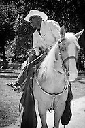 """Photographs of African American cowboys/cowgirls at work and play during their annual """"High Noon Ride"""" for charity staged in Washington Park located in the heart of Chicago's South Side neighborhood."""