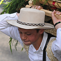 Peasants or silleteros, continue the tradition of bringing from the mountains heavy flower bouquetes, before to to sell in town, nowadays to be part of the celebrations. Silleteros Parade at the Medellin flower festival