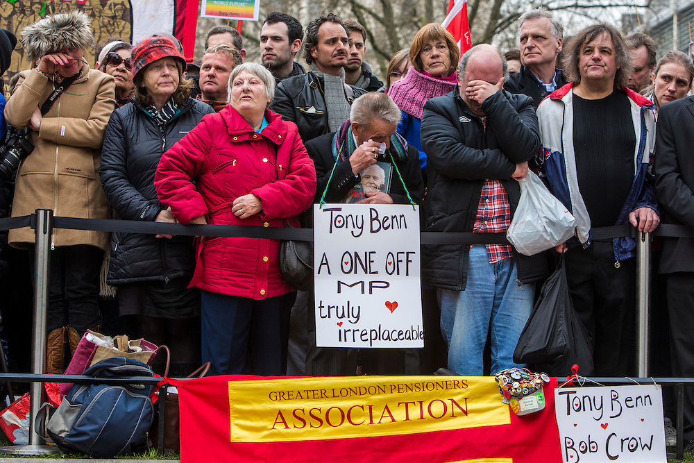 Crowds, including trade unionists and anti-war campaigners gather outside the Palace of Westminster Chapel to pay their last respects as the coffin is lead into the church for the funeral of the veteran Labour politician Tony Benn.