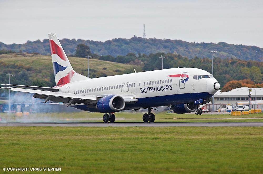 A British Airways (BA) plane landing at Edinburgh aiport, Scotland, UK