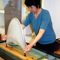 Asia, China, Suzhou. Silk stretching for process of filling silk comforters.