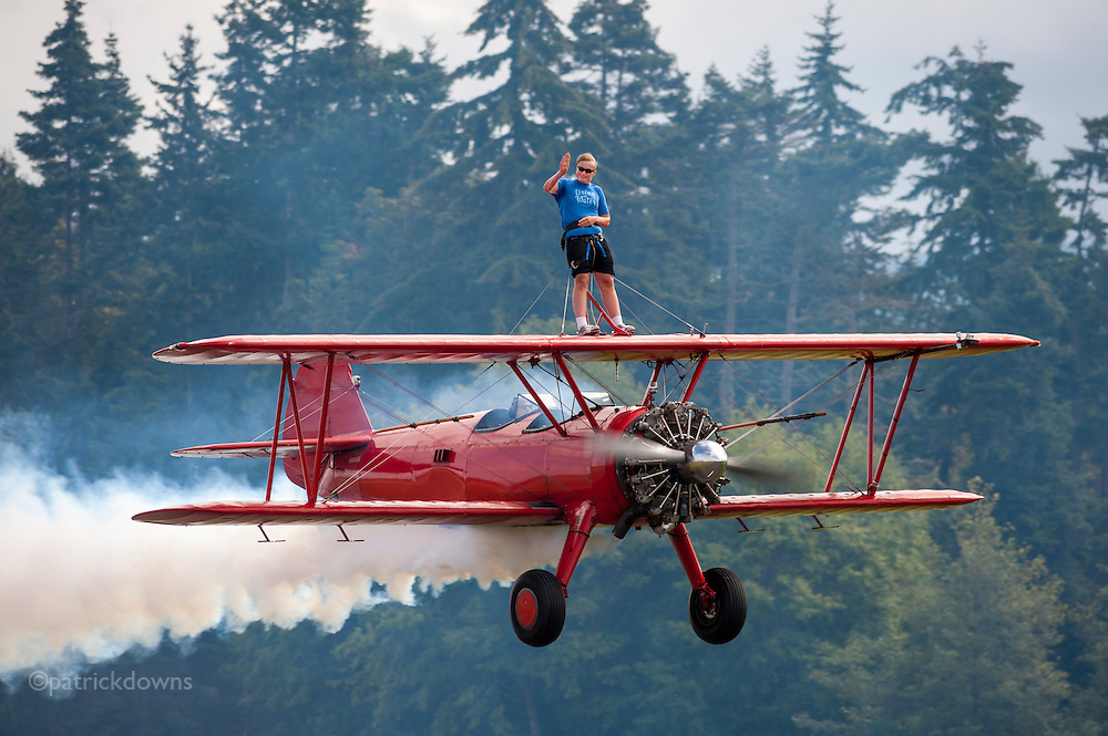 14 year old Weston Mason wing walks on a Stearman biplane, with his father Mike flying the plane. Mike and his wife Marilyn teach wing-walking to students from all over the world. They live in Sequim, WA. http://www.king5.com/media/cinematic/video/14885092/wing-walking-family/