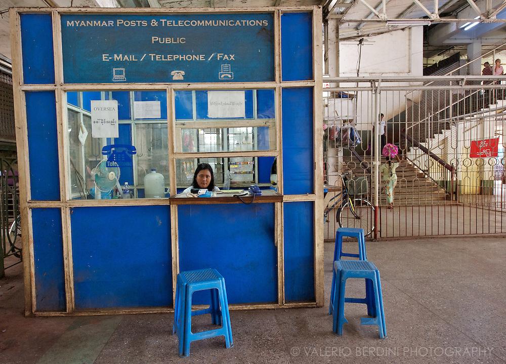 A public telephone box in the Rangoon central railway station.