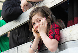 London, March 13th 2016. The annual St Patrick's Day Parade takes place in the Capital with various groups from the Irish community as well as contingents from other ethnicities taking part in a procession from Green Park to Trafalgar Square.  PICTURED: A girl waits for the parade to begin. &copy;Paul Davey<br /> FOR LICENCING CONTACT: Paul Davey +44 (0) 7966 016 296 paul@pauldaveycreative.co.uk