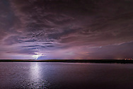 A thunderstorm and lightning bolt over a prairie pond in southern Alberta. This is one frame from 275 shot for a time-lapse sequence, June 10, 2015. This is an 8-second exposure at f/2 with the Sigma 24mm lens and Nikon D750 at ISO 1600.