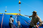 Cole Bros. Circus workers set up the Big Top at the Prince William County Fairgounds in Manassas, Va.