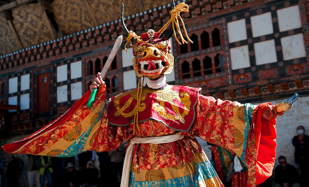 Monks dance in costume at the Black Hat festival in Bumthang, Bhutan.