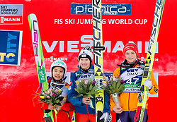 Second placed Sara Takanashi of Japan, winner Daniela Iraschko-Stolz of Austria and third placed Carina Vogt of Germany celebrate during flower ceremony after the 11th Women FIS Ski Jumping World Cup competition in Planica replacing Ljubno  on January 25, 2014 at HS95, Planica, Slovenia. Photo by Vid Ponikvar / Sportida