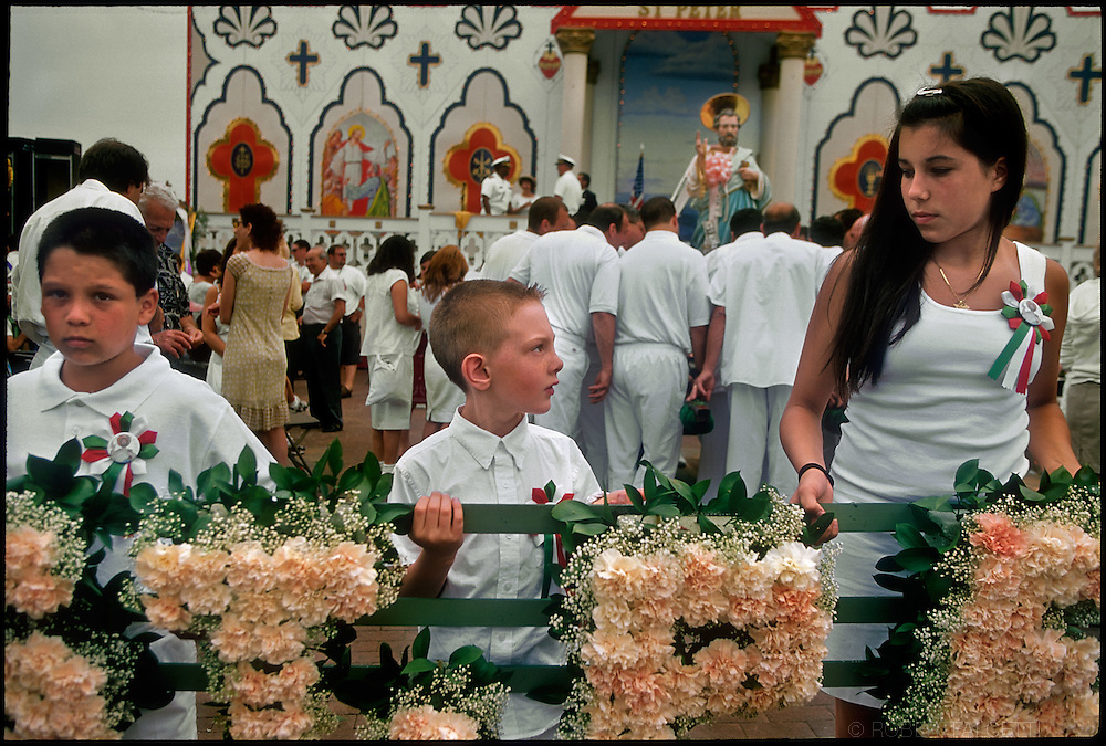 GLOUCESTER, MA- JUNE 29, 2003:  Children prepare to carry the lead rose decoration during the annual celebration paying homage to St. Peter, the patron saint of fishermen in Gloucester, MA. The festa takes place on the weekend closest to the Feast Day of St. Peter, June 29. .(Photo by Robert Falcetti) . .