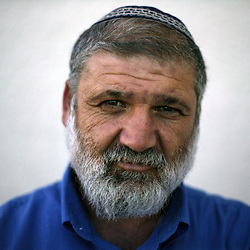 """Moshe Baranes, 40, a city hall worker and student, and a resident of the Gush Katif settlements, is seen in Gaza, Palestinian Territories, Nov. 4, 2004. When asked his thoughts about being forced to leave the settlements, he responded, """"God willing, we will do everything in our power not to be separated. I pray this is not going to happen."""" Israel's parliament recently supported compensation payments for Jewish settlers leaving the Gaza Strip, in a vital vote for Prime Minister Ariel Sharon's plan to evacuate the occupied territory."""