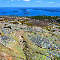 Vista from Cadillac Mountain in Acadia National Park, Maine<br /> The panoramic view of Frenchman Bay and the Porcupine Islands from this elevation of 1,528 feet is spectacular. The overlook at Cadillac Mountain is a breathtaking highlight of Arcadia National Park. Marvel at this waterscape created during the Ice Age 10,000 to 17,000 years ago. This vista is especially incredible as the sun makes its first appearance in the United States each morning.