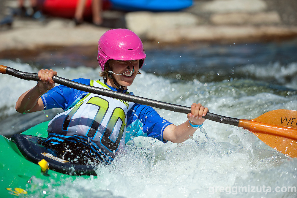Kathryn Walker still having fun playing in the water following Round 2 of the Payette River Games women's  kayak Xross race at Kelly's Whitewater Park in Cascade, Idaho on June 21, 2014.