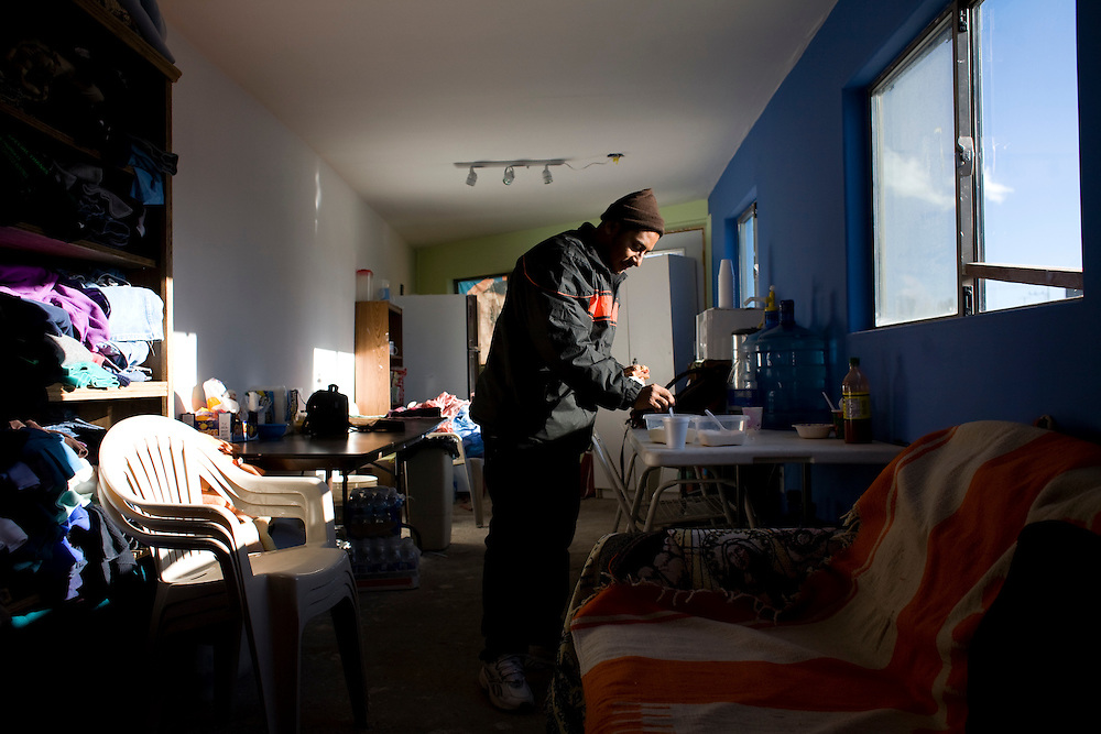 A man who recently crossed illegally to the United States and was returned to Mexico by the Border Patrol makes a cup of coffee at the Migrant Resource Center in Naco, Sonora, Mexico, on Wednesday, Jan. 30, 2008. The Migrant Resource Center is a bi-national project of Citizens for Border Solutions (Bisbee, AZ) and Iglesia del Camino (Naco, Mexico), with support from other organizations and individuals.