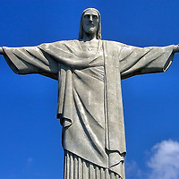 Christ the Redeemer Statue on Corcovado Mountain in Rio de Janeiro, Brazil<br /> The majestic Christ the Redeemer statue stands atop the 2,300 foot Corcovado Mountain in Rio de Janeiro. This Jesus Christ figure has outstretched arms symbolizing peace. It was made from sandstone and concrete in 1931 and is the world&rsquo;s tallest art deco statue at 124 feet. Although you can travel through the Tijuca Forest National Park for a close inspection, this icon of Brazil can be seen from almost anywhere in the city.
