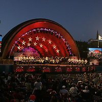 Boston Pops fans fill the lawn in front of the Hatch Shell at the Boston Pops Fireworks Spectacular on Independence Day, July 4, 2009 in Boston, Massachusetts.  Photo by Matthew Healey