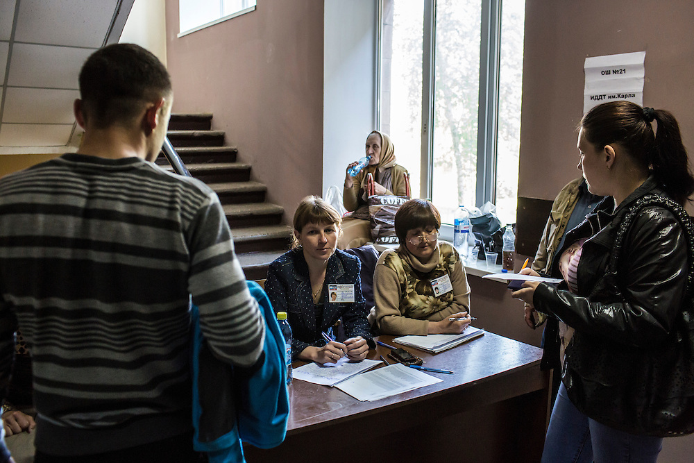 MARIUPOL, UKRAINE - MAY 11: Poll workers and voters inside a polling station on May 11, 2014 in Mariupol, Ukraine. A referendum on greater autonomy is being held after pro-Russian activists took over at least ten cities in the eastern part of the country. (Photo by Brendan Hoffman/Getty Images) *** Local Caption ***