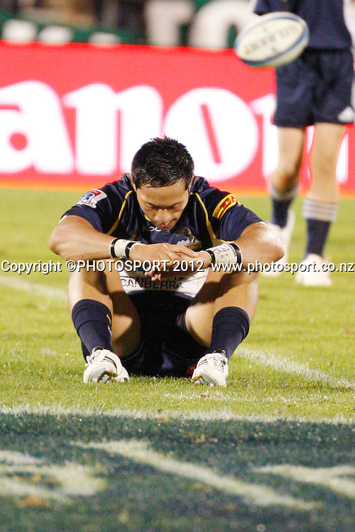 Dejected Brumbies Christian Lealiifano after their game at Baypark Stadium, Mt Maunganui, New Zealand. Friday,16 March 2012. Photo: Dion Mellow/photosport.co.nz