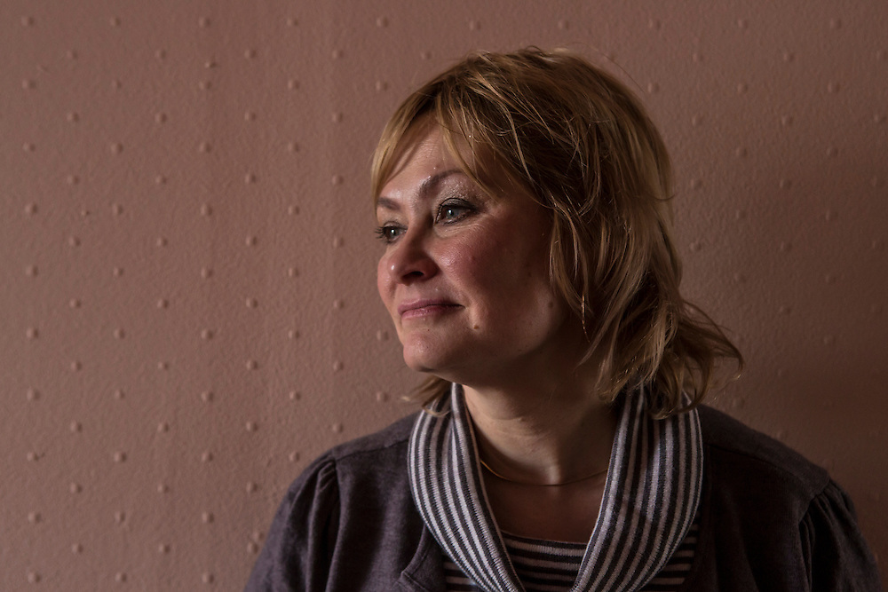 Inessa Rozova, Alexander Panin's mother, poses for a portrait in Panin's grandmother's apartment, where he was mostly raised, on Tuesday, February 25, 2014 in Tver, Russia. Panin, a Russian citizen who was arrested in the Dominican Republic in June 2013, is set to be charged by federal authorities in the US with being part of a gang which robbed bank accounts via the Internet. Photo by Brendan Hoffman, Freelance