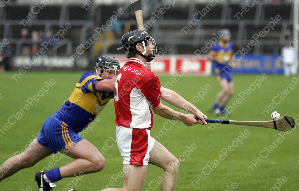 Newmarket's James McInerney goes for the block as Eire Og's Tadhg MacNamara  tries to get the  ball away in Cusack Park on Sunday.<br /> <br /> Photograph by Yvonne Vaughan.