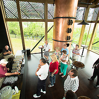 Visitors enjoy samples of bourbon in the tasting room of the new visitor's center at Wild Turkey Distillery in Lawrenceburg, Ky., on 5/13/14