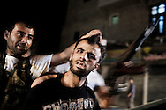 SYRIA, ALEPPO. A man, allegedly Shabbiha (Regime civil militia), is shown by rebel forces after they arrested him on September 25, 2012. ALESSIO ROMENZI