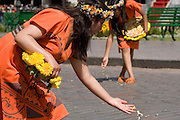"""The Virgins of the Sun scatter  petals to consecrate the path where the Inca will pass on his golden throne. Inti Raymi """"Festival of the Sun"""", Plaza de Armas, Cusco, Peru."""