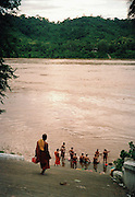 Monks bathing in the Mekong River.