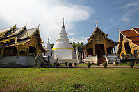 Wat Phra Singh or Wat Phra Singh Woramahaviharn:  Viharn Lai Kham, Bot, Chedi and Vihard Luang -  Wihan Luang - the original wihan was replaced by the present building in 1925.  Wihan Lai Kham - the main attraction of the complex was built in 1345 to house the Phra Buddha Singh statue and it is a prime example of classical Lanna architecture.  The main chedi of the complex features the front half of an elephant emerging from it. After it was built in 1345, the chedi was enlarged several times.
