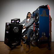 Future Shock is the title of the exhibition by Nicholas Ragbir and Anil Bhimraj at the Queens Museum of Art.  They are from Trinidad living in Queens, New York for less than 5 years, turning ordinary BMX bikes into stereo bikes the size of a small car.  Each bike may take them up to 4 weeks to build in their inconspicuous garage in Queens, each one costing thousands of dollars of electrical and sound equipment.  After they are finished, in the summer they ride around in groups and take turns in playing tunes.  It doesn't seem to bother the neighbours, they all think the 19 year old kids are doing something great for their future, even thought they are spending a lot of money.  The bikes are on exhibition at the Queens Museum  of Art from January 24th - April 26th....Image © Arsineh Houspian/Falcon Photo Agency