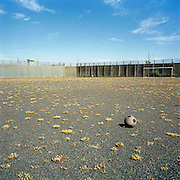 An old football lies in the exercise yard of the Maze Prison, near Lisburn, Northern Ireland, on Tuesday, July 18, 2006. The Maze Prison near Lisburn, Northern Ireland, on Tuesday, July 18, 2006. HM Maze Prison, also known as Long Kesh and the H-Blocks, held some of the most dangerous men in Europe during its 30 year operation. The prison closed in September 2000 after 428 prisoners had been released under the Good Friday Agreement. There are now plans to turn the abandoned site into a national football stadium.