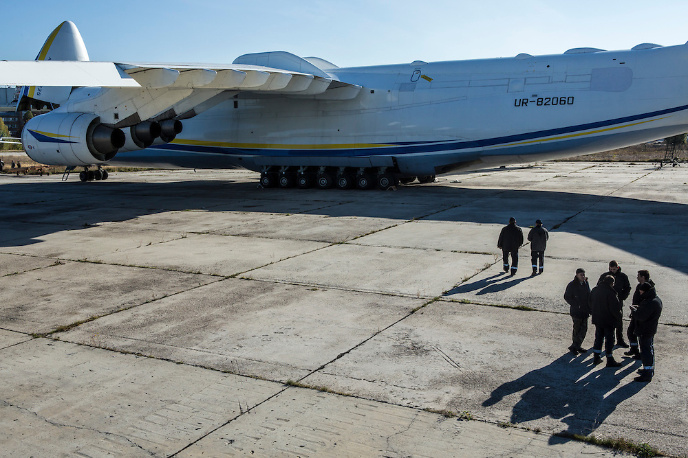 GOSTOMEL, UKRAINE - OCTOBER 1, 2014: Maintenance workers stand near the Antonov AN-225, the longest and heaviest airplane ever built, on an airfield in Gostomel, outside Kiev, Ukraine. CREDIT: Brendan Hoffman for The New York Times