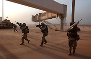 U.S. Army 3rd Division 3-7 infantry troops push towards the main terminal of Baghdad International Airport during an allied advance April 4, 2003 on the Iraqi capital. U.S. and Iraqi forces exchanged heavy fire throughout the day as they battled for control of the strategic facility.