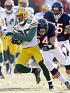 .Green Bay Packers' Greg Jennings is tackled by Chicago Bears' Brian Urlacher after a 1st quarter reception. .The Green Bay Packers traveled to Soldier Field in Chicago to play the Chicago Bears in the NFC Championship Sunday January 23, 2011. Steve Apps-State Journal.