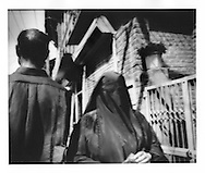 "Woman wearing a ""burkha"" plies the streets of Srinagar, Indian Administered Kashmir."