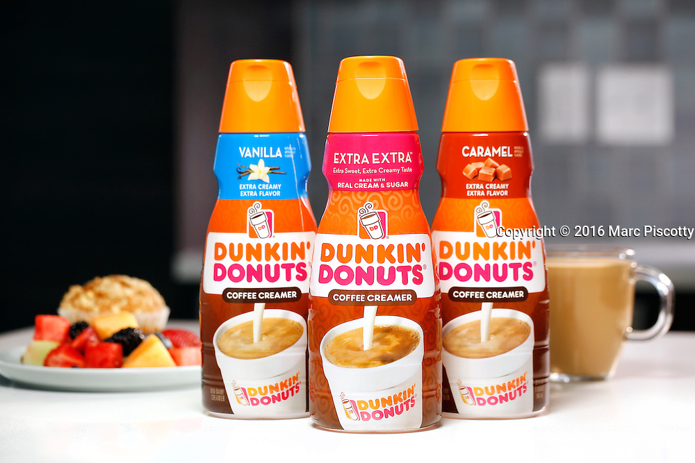 SHOT 4/12/16 3:25:51 PM - Dunkin' Donuts creamers packaging photography. Coffee creamer flavors included Vanilla, Extra Extra and Caramel.   (Photo by Marc Piscotty / © 2016)