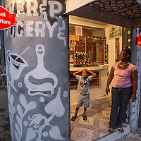 Paulette Coley and her son, Jabari, in their store in Old Harbour Bay, Jamaica