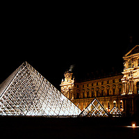 The Louvre Pyramid (Pyramide du Louvre),designed by I.M. Pei, is a large glass and metal pyramid, surrounded by three smaller pyramids, in the main courtyard (Cour Napoléon) of the Louvre Palace (Palais du Louvre) in Paris. The large pyramid serves as the main entrance to the Louvre Museum.