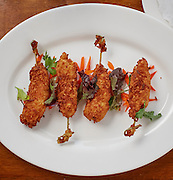 Beer batttered shrimp with blackened seasoning, sweet coconut and dry coconut served with orange marmalade.