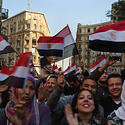 Egyptians continue to celebrate waving flags and singing patriotic songs on a street near Talat Harb square February 12, 2011 in Cairo, Egypt. The day after the revolution toppled the regime of President Hosni Mubarak, Egyptians continued to celebrate and began to focus on rebuilding their country and society. .(Photo by Scott Nelson)