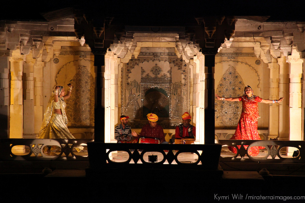 Asia, India, Udaipur. Dancers perform at City Palace during gangaur cruise from Taj Lake Palace..