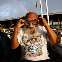 CRYSTAL RIVER, FL -- January 4, 2009 --  Alberto Escandon of Pensacola, Fla., tries on his snorkeling gear with his friend Kathy Zoss, left, to swim with manatees during a American Pro Diving Center tour in Crystal River, Fla., on Sunday, January 4, 2009.  Crystal River is the home of the nation's largest population of manatees, who will often come right up to humans on the various snorkeling and scuba tours of the area.  (Chip Litherland for The New York Times)