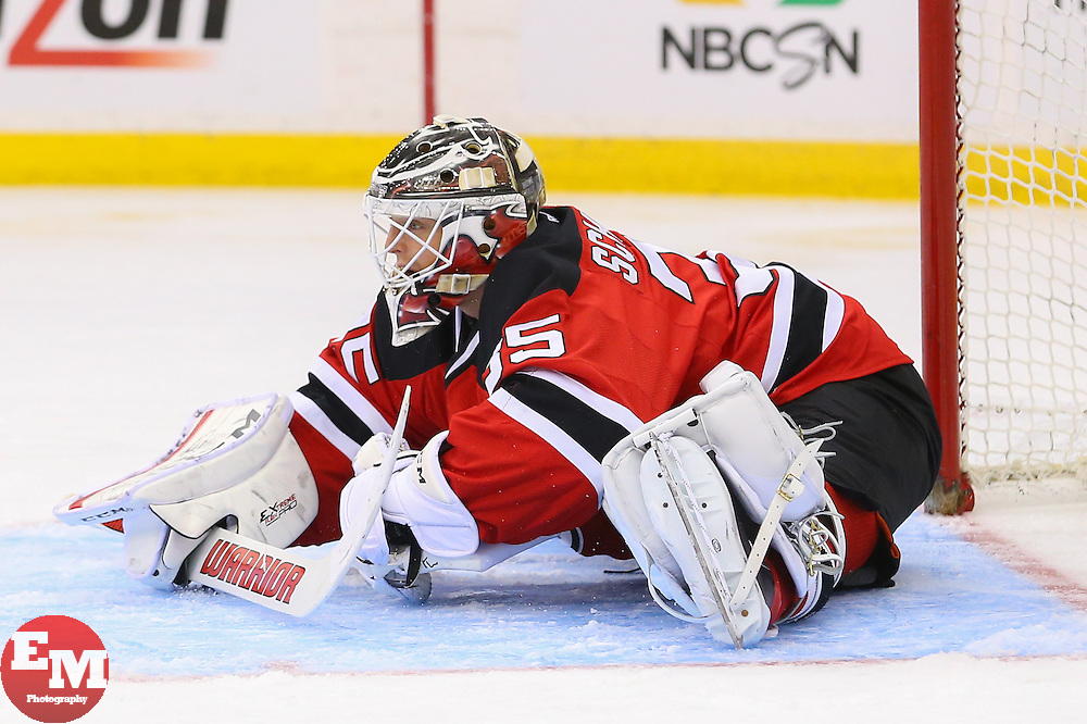 Mar 31, 2014; Newark, NJ, USA; New Jersey Devils goalie Cory Schneider (35) stretches after replacing New Jersey Devils goalie Martin Brodeur (30) during the second period at Prudential Center.