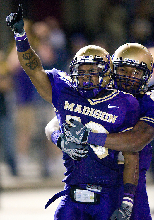 James Madison's Scotty McGee celebrates with a teammate following a 99-yard kickoff return at the start of the second half against Appalachian State at Bridgeforth Stadium in Harrisonburg Saturday Night. JMU upset the number 1 ranked Mountaineers 35-32.