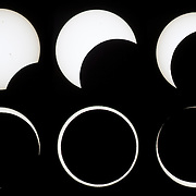 A composite of six images shows the progression of the annular solar eclipse of May 20, 2012 as viewed from Lassen Volcanic National Park in California. The Moon's distance from Earth varies, and annular solar eclipses occur when the Moon is relatively far from Earth. The Moon appears smaller in the sky and therefore is not able to block the entire Sun. At the peak of this eclipse, the Moon blocked 95 percent of the Sun. This image sequence begins at the top left. The black marks on some of the Sun images are sunspots.